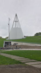 Delft's university library is a striking modern structure built into a hill. The cone section contains 5 concentric rings of study areas, and the top is a skylight.