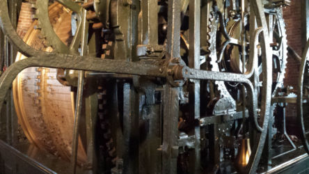 Some of the machinery operating the belltower's clock.