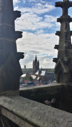 The Oude Kerk through stonework on the Nieuwe Kerk's belltower
