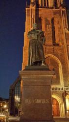 A statue of Hugo Grotius, in front of the Nieuwe Kerk