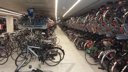"This is the ""parking lot"" of the Delft train station. There are a number of rows just like this, it's a pretty breathtaking number of bicycles."